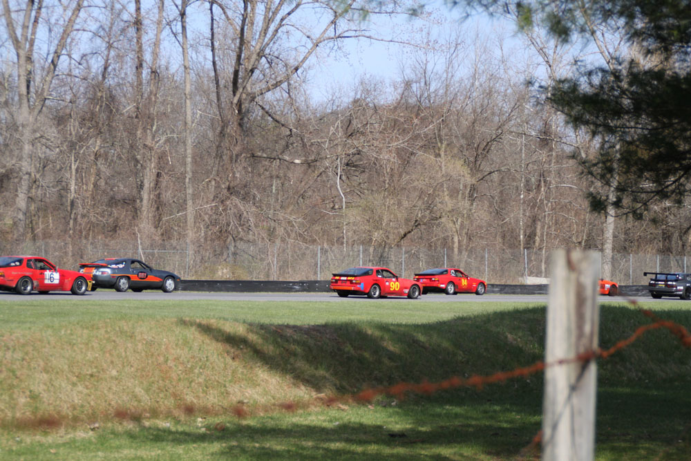 Chris Clapper, #84 Class SP1 and John Shafer, #6t1 Class C on Lime Rock front straight.
